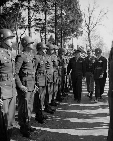 General Dwight D, Eisenhower, Supreme Allied Commander, inspects men of the US, 101st Airborne, Div, He presented it with the Presidental Citation Unit for the heroic stand at the 'Bastion of Bastogne' in France (March 15, 1945), Behind General Eisenhower is Maj, Gen, Maxwell Taylor, Commander of the unit. (Photo by Photo12/UIG/Getty Images)