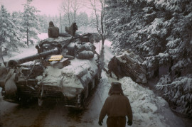 American Sherman M4 tank moves past anot